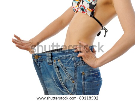 slim girl after diet in old big jeans - stock photo