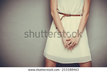 Slim girl in bright dress with belt on gray, part body. Fashion woman posing. Vintage tone - stock photo