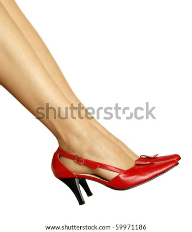Slim legs and red shoes - stock photo