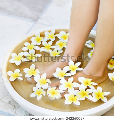 Slim legs of beautiful girl with aromatherapy bowl - stock photo