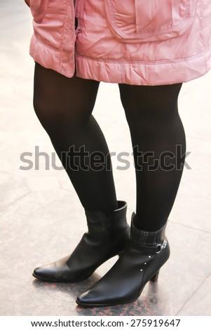 Slim model legs in stockings. winter fashion creation. - stock photo