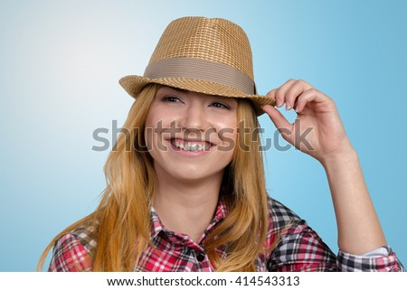 Slim pretty young girl in straw hat - stock photo