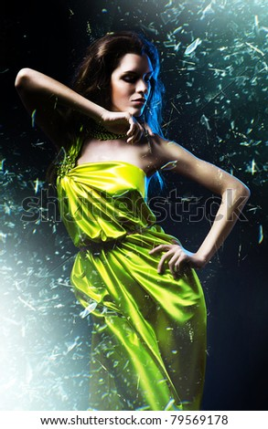 slim sexy woman in green dress and shuttered glass - stock photo