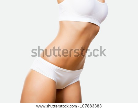 Slim tanned woman's body - stock photo