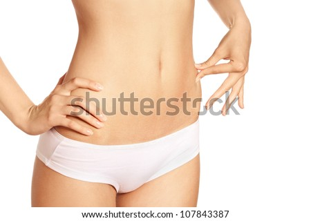 Slim tanned woman's body isolated over white background. Healthy lifestyles concept. - stock photo