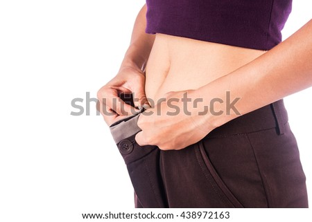 Slim waist of beauty woman in big trousers,after weight loss - stock photo