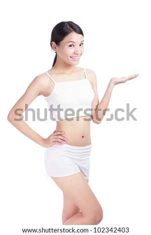 Slim woman body and she smile introduce something on empty copy space isolated over white background, ,model is a asian beauty - stock photo