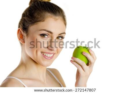 Slim woman holding green apple on white background - stock photo