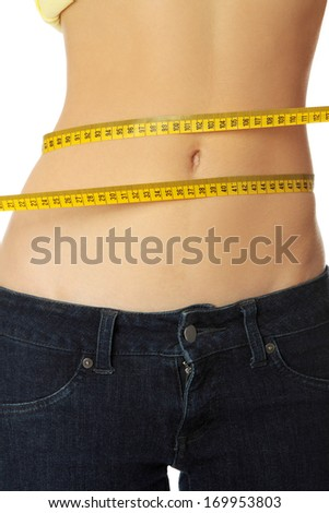 Slim woman's body with measuring tape. Over white. - stock photo