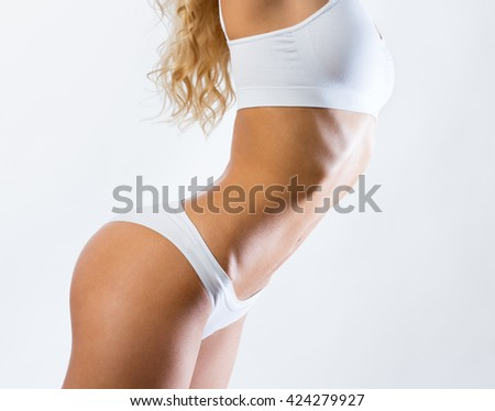 Slim woman shows her beautiful body - stock photo