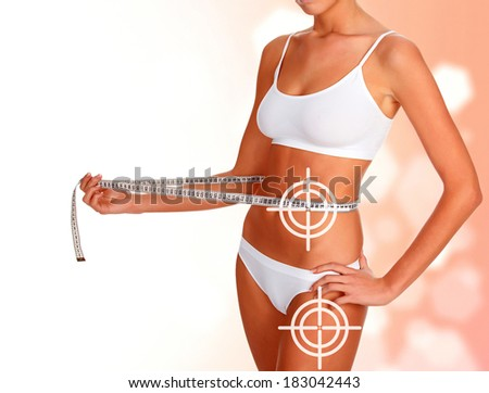 Slim woman with tape measure, weightloss concept - stock photo
