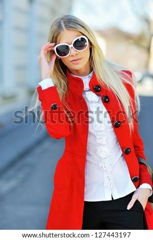 Slim young beautiful woman wearing sunglasses - stock photo