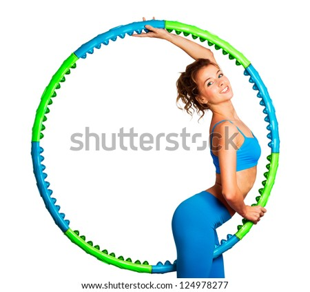 Slim Young Woman with Hula Hoop - stock photo
