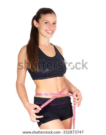 Slim Young Woman with perfect healthy fitness body, measuring her thin waist with a tape measure. Caucasian female in sportswear, over white background.Diet and weight loss concept. - stock photo