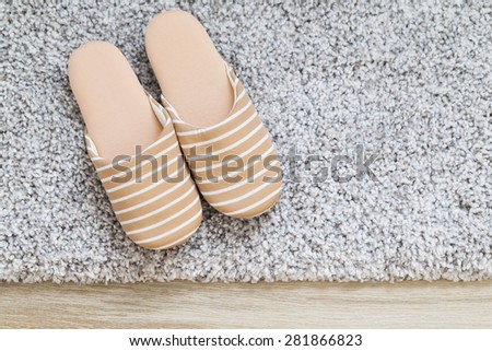 Slipper on carpet - stock photo