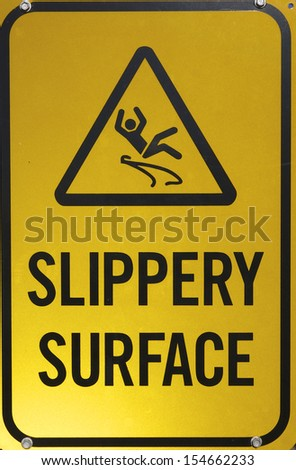 Slippery Surface sign - stock photo