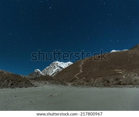 Slope of Kala Patthar in the Moonlight from Gorak Shep - Everest region, Nepal, Himalayas - stock photo