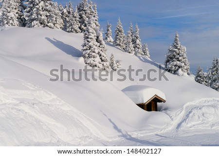 Slope on the skiing resort. Snow-covered house - stock photo