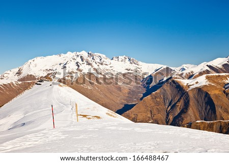 Slopes of ski resort in French Alps - stock photo