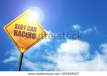 slot car racing, 3D rendering, a yellow road sign - stock photo