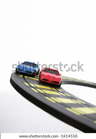 Slot cars racing on curve. - stock photo