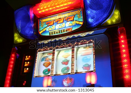 Slot machine with colorful lights and graphics - stock photo