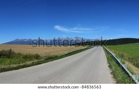 Slovakia beauty, road with panorama of High Tatras mountain - stock photo
