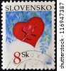SLOVAKIA - CIRCA 2004: A stamp printed in Slovakia shows a poppy on a red heart, circa 2004 - stock photo