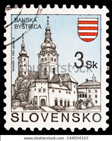 SLOVAKIA - CIRCA 1994: A stamp printed in Slovakia  shows image of architecture in Banska Bystrica, circa 1994 - stock photo