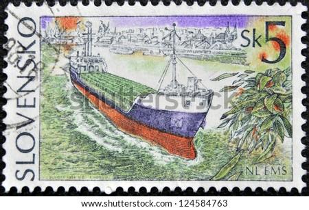 SLOVAKIA - CIRCA 1994: A stamp printed in Slovakia shows merchant ship, circa 1994 - stock photo