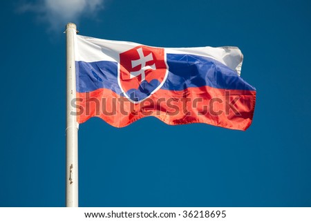 Slovakia flag against blue sky - stock photo