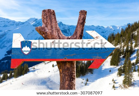 Slovenia Flag wooden sign with winter background - stock photo
