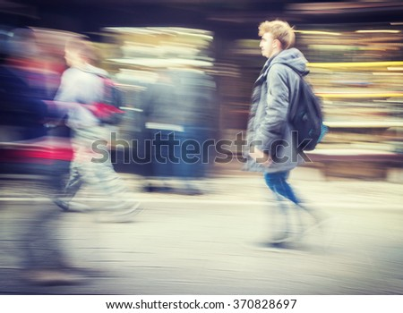 Slow blur motion people walking on the street - stock photo