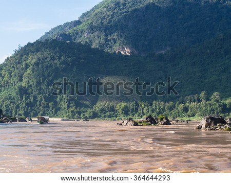 Slow boat cruise on the Mekong River in Laos - stock photo