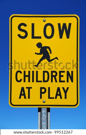 Slow Children at Play street sign with blue sky background - stock photo