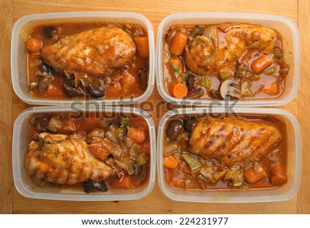 Slow-cooked chicken dinner portions being prepared for freezing or chilling. - stock photo
