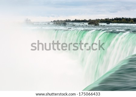 Slow exposure Close up of the rushing Niagara Falls  - stock photo