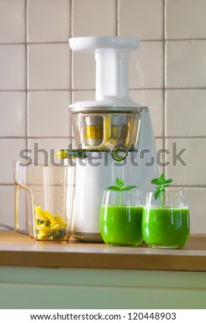slow juicer with weed grass juice - stock photo
