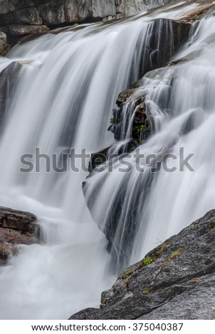 Slow Shutter, Pacific Northwest Waterfall in Cascade Mountains - stock photo