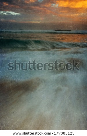 Slow shutter was used to create a dreamy water look at  Hookapa Beach in Maui at sunrise.  This image is enhanced with a texture overlay filter. - stock photo