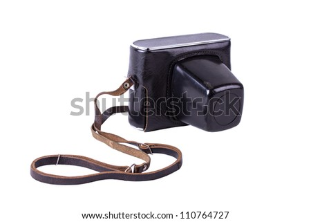 SLR camera in the leather cover isolated on white background - stock photo