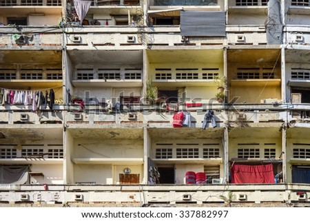 Slum facade in asia with laundry hanging on the balconies - stock photo