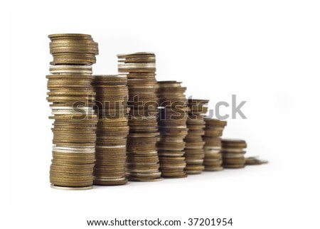 Slump or growth - towers assembled of coins shallow DOF with focus on the left side - stock photo
