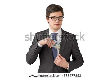 Sly man putting one hundred dollar banknotes into the chest pocket. Isolated. Concept of getting money. - stock photo