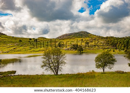 Smal lake in landscape of Norway. - stock photo