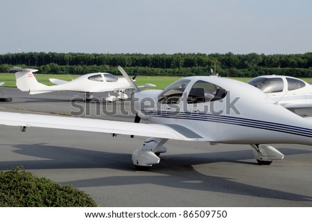 Small airplanes Small airplanes standing at a small airport - stock photo