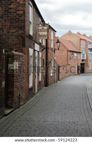 Small alley in England. - stock photo