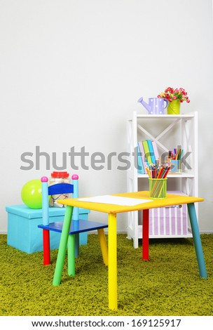 Small and colorful table and chair in room - stock photo