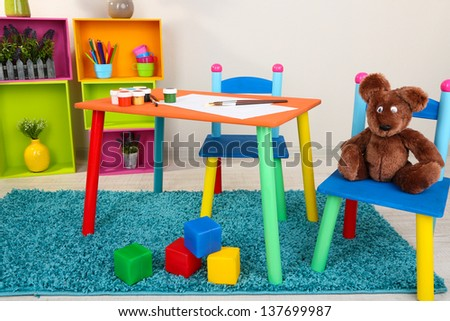 Small and colorful table and chairs for little kids - stock photo