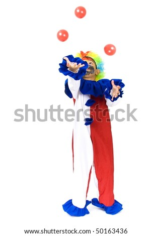 Small and happy clown playing with balls. - stock photo